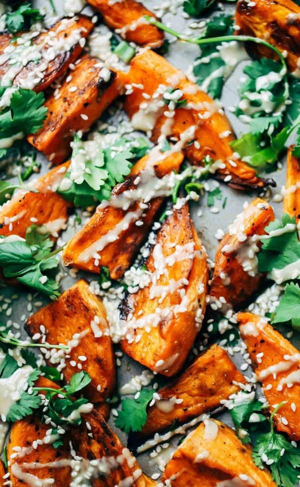30-minute sesame roasted sweet potatoes Who doesn't love some crispy roasted sweet potatoes? Topped with tahini, sesame oil, cilantro, and sesame seeds these roasted sweet potatoes are easy to make and delicious.