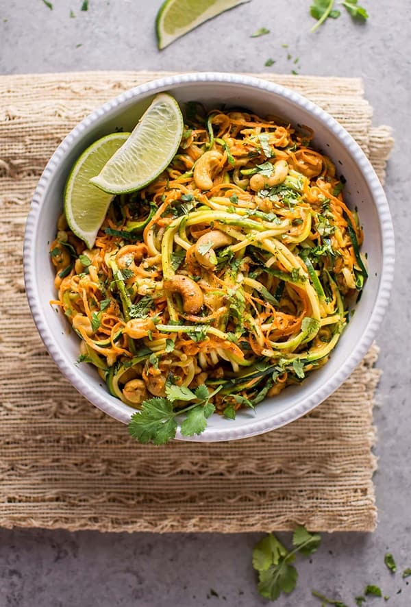 Garlic and Lime Noodles - Genius healthy and low-carb spiralizer recipes you need to try. Plus all the tricks and tips you need to know to spiralize zucchini and any other vegetables, and how to store them to keep them fresh for longer!