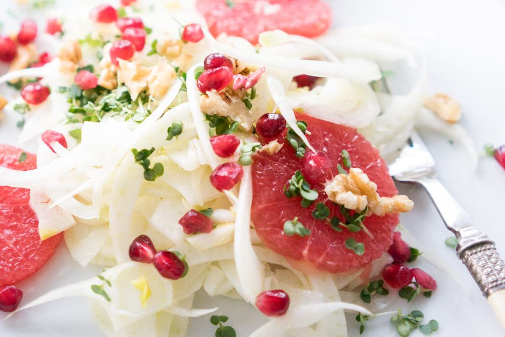 A festive and colourful salad that will brighten up any winter day. A delicious mix of crunchy pomegranate seeds and walnuts with grapefruit and fennel.