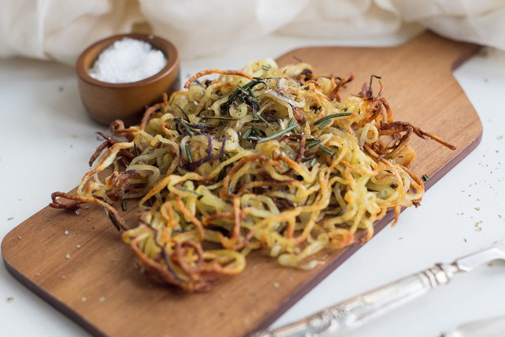 So good and healthy, these spiralized baked potatoes are a dream! These baked fries are simply delicious. Super crispy on the outside and soft and fluffy on the inside! If you love spiralized veggies, you need to try these!