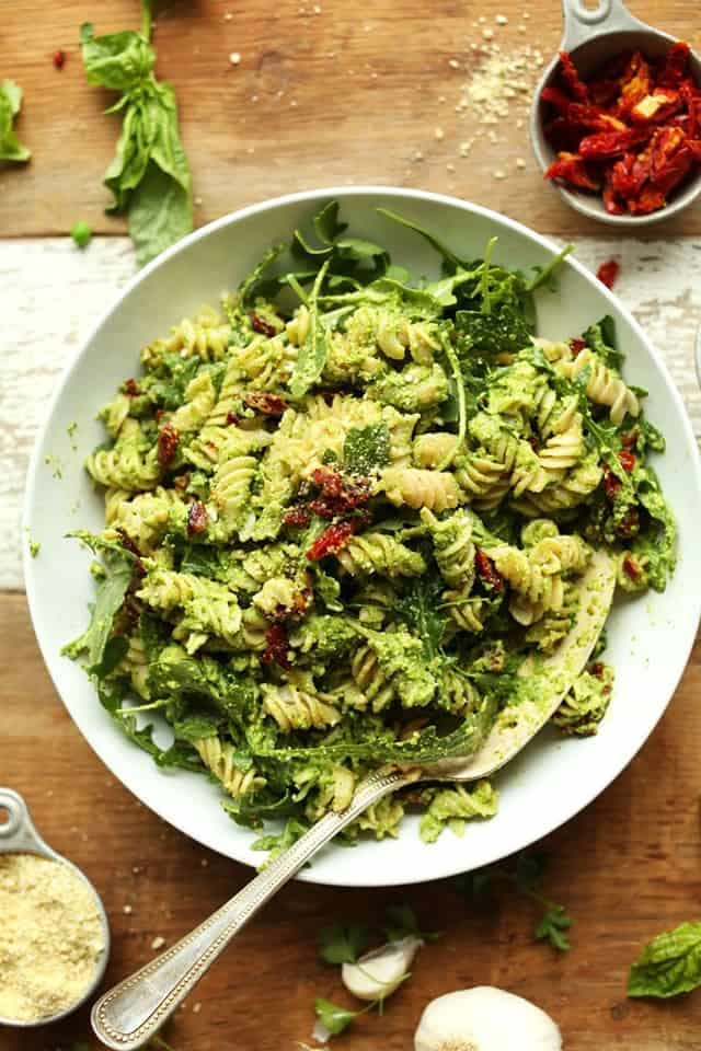 Pea Pesto Pasta With Sun-Dried Tomatoes & Arugula | Over 30 eggcellent vegan Easter recipes that are guaranteed to impress! The best vegan breakfast, brunch, lunch and dinner ideas to impress your family! Plus some delicious dessert recipes to make your Easter special.