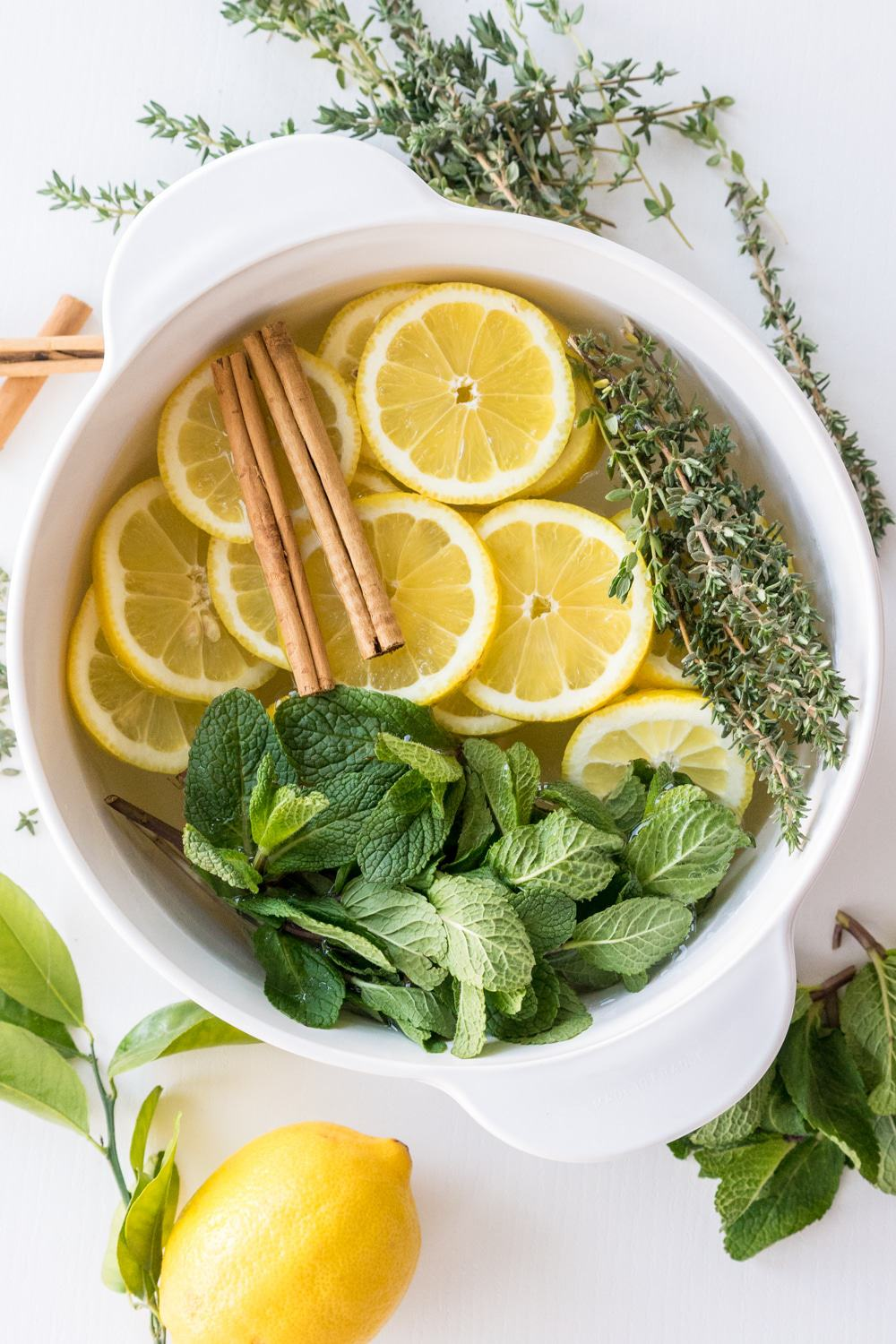 Lemon, Cinnamon, Mint And ThymeStove Top Potpourri | These Stove Top Potpourri ideas create an amazing natural homemade scent that will bring the smell of spring into your home. Such easy recipes that you can leave on your stove all day long simmering. Each one will fill your home with a fresh aroma as you do your spring cleaning!