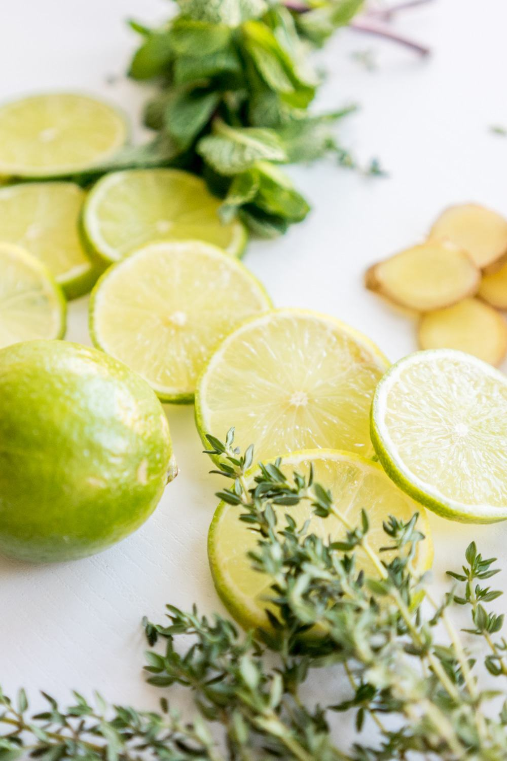 Lime, Mint, Ginger And Thyme Stove Top Potpourri | These Stove Top Potpourri ideas create an amazing natural homemade scent that will bring the smell of spring into your home. Such easy recipes that you can leave on your stove all day long simmering. Each one will fill your home with a fresh aroma as you do your spring cleaning!