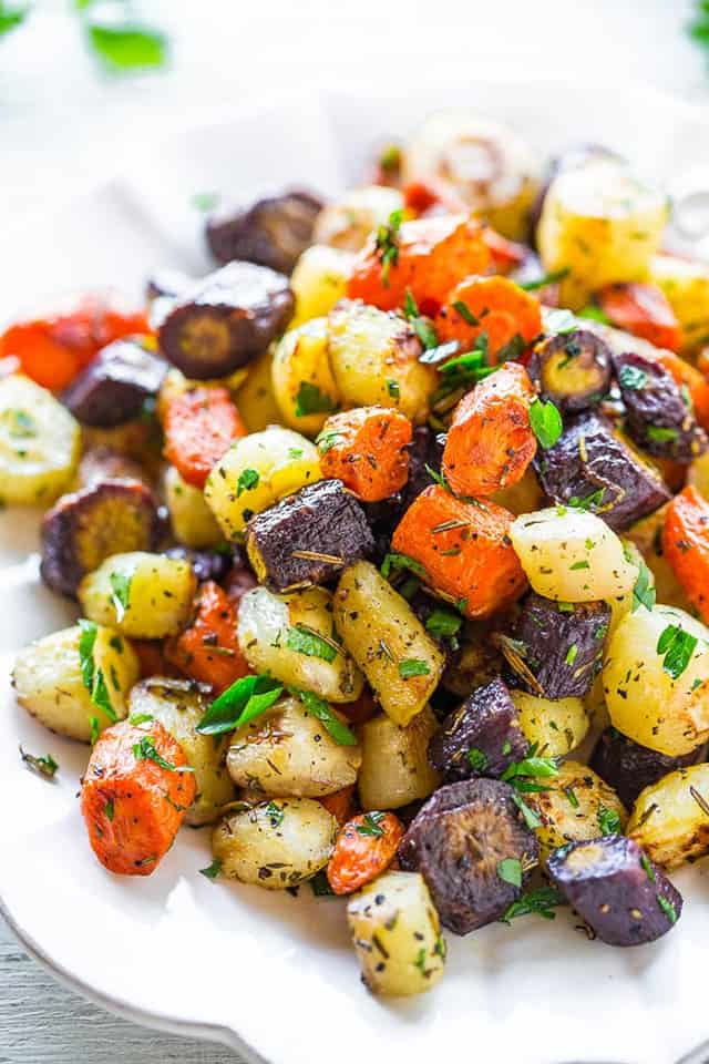 Herb-Roaster Tri-Colored Carrots | Over 30 eggcellent vegan Easter recipes that are guaranteed to impress! The best vegan breakfast, brunch, lunch and dinner ideas to impress your family! Plus some delicious dessert recipes to make your Easter special.
