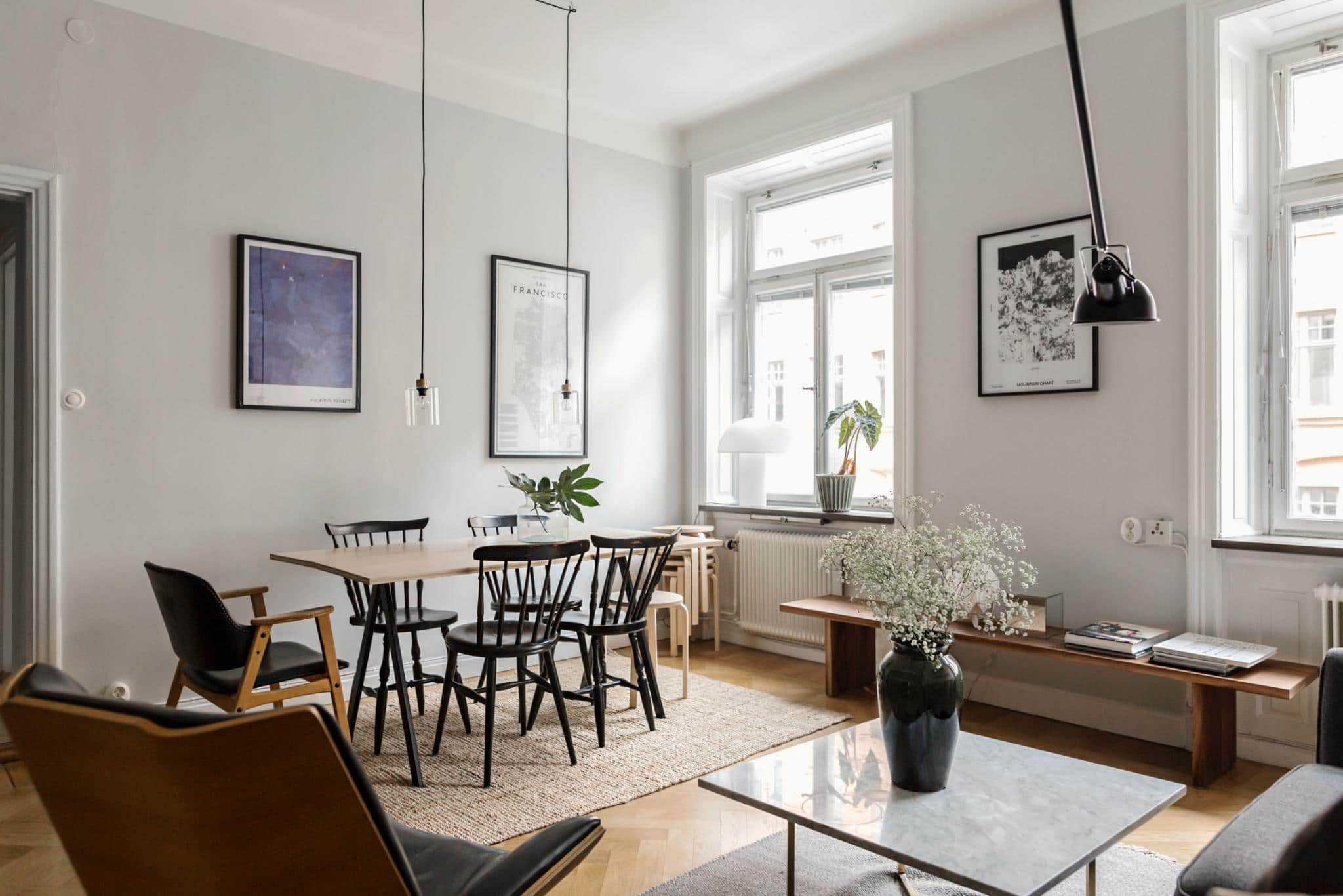 A Scandinavian inspired living room with grey walls and big windows. This dreamy Swedish apartment & How To Decorate A Small Apartment: 10 Secrets - Gathering Dreams