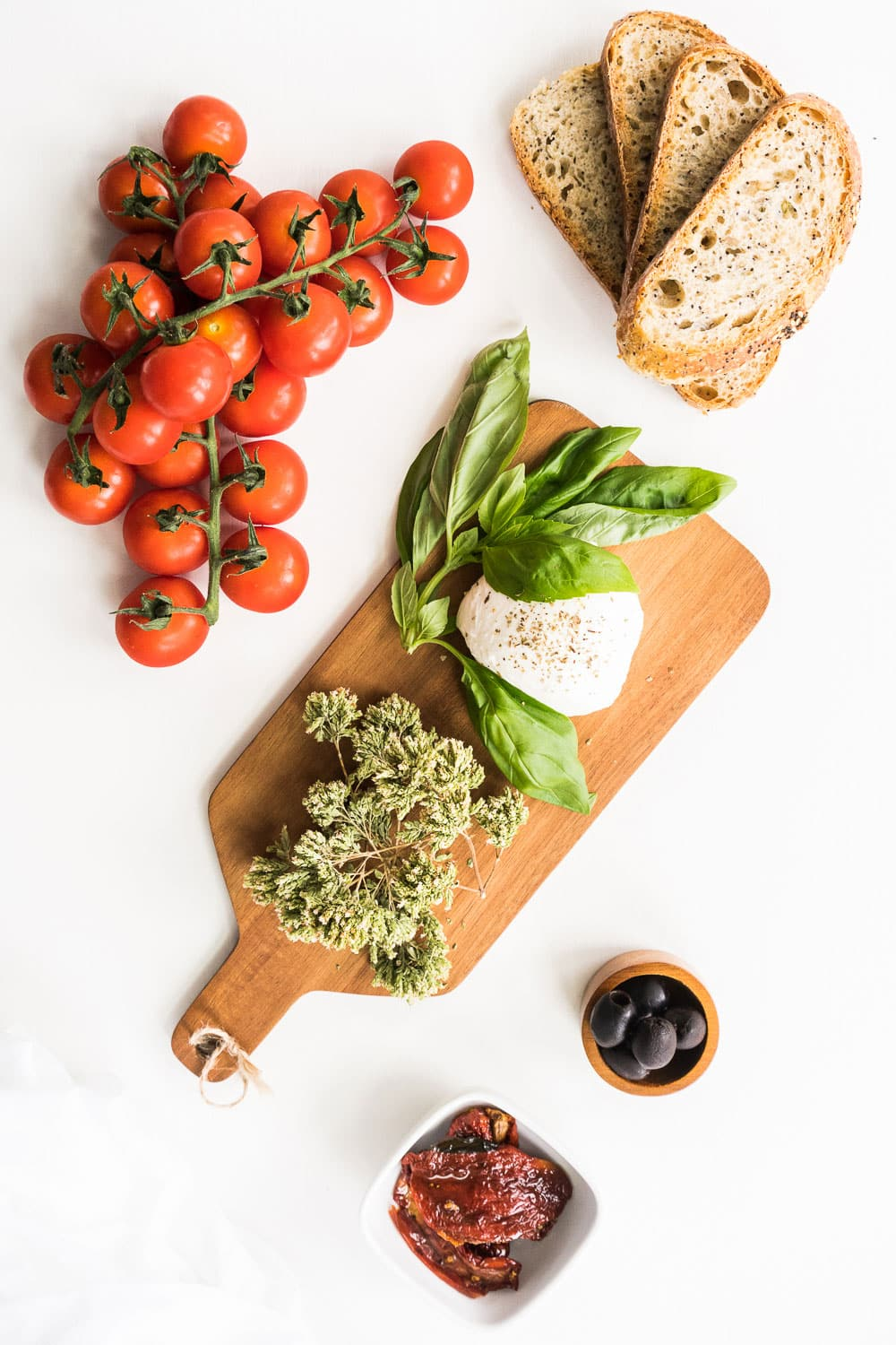 All the ingredients for the perfect bruschetta! Grilled smoky bread, delicious sun-ripened tomatoes, sun-dried tomatoes, extra virgin olive oil, delicious mozzarella and black olives make this the ultimate appetizer for your summer parties!