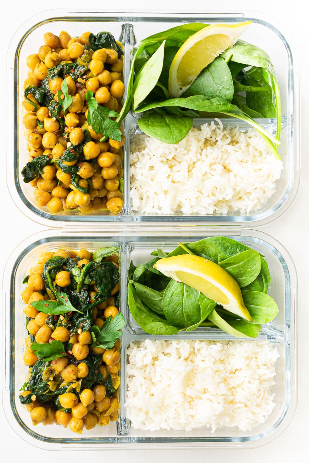 2 glass containers with chickpea curry, basmati rice and fresh spinach: if you love chickpea curry you need to try this!
