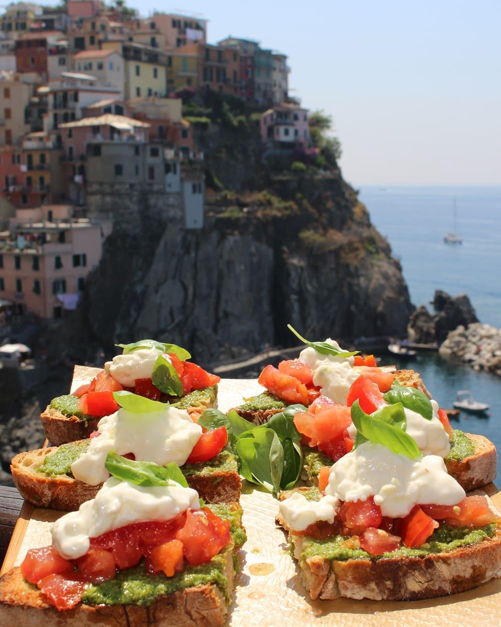 Restaurants in Cinque Terre: Nessun Dorma in Manarola - View of bruschette with stunning Manarola in the background
