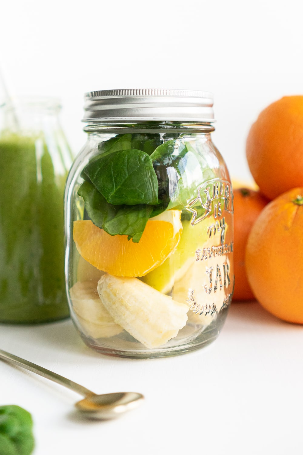 How to meal prep a green smoothie: place all ingredients in a jar or freezer bag and freeze