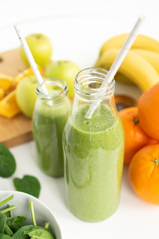 Green smoothie in a milk bottle