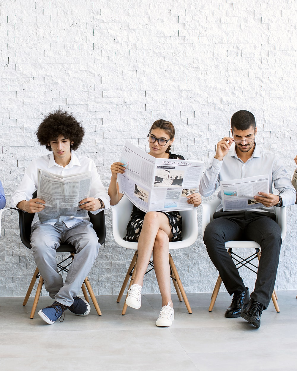 People reading business newspapers, waiting to be called to a focus group. Make money online. Make $100 dollars a day with focus groups.
