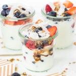 Yogurt parfaits in glass jars with mixed berries