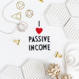 "Thumbnail of 31 Passive Income Ideas for Beginners: flat lay of black letters saying ""I love passive income"""