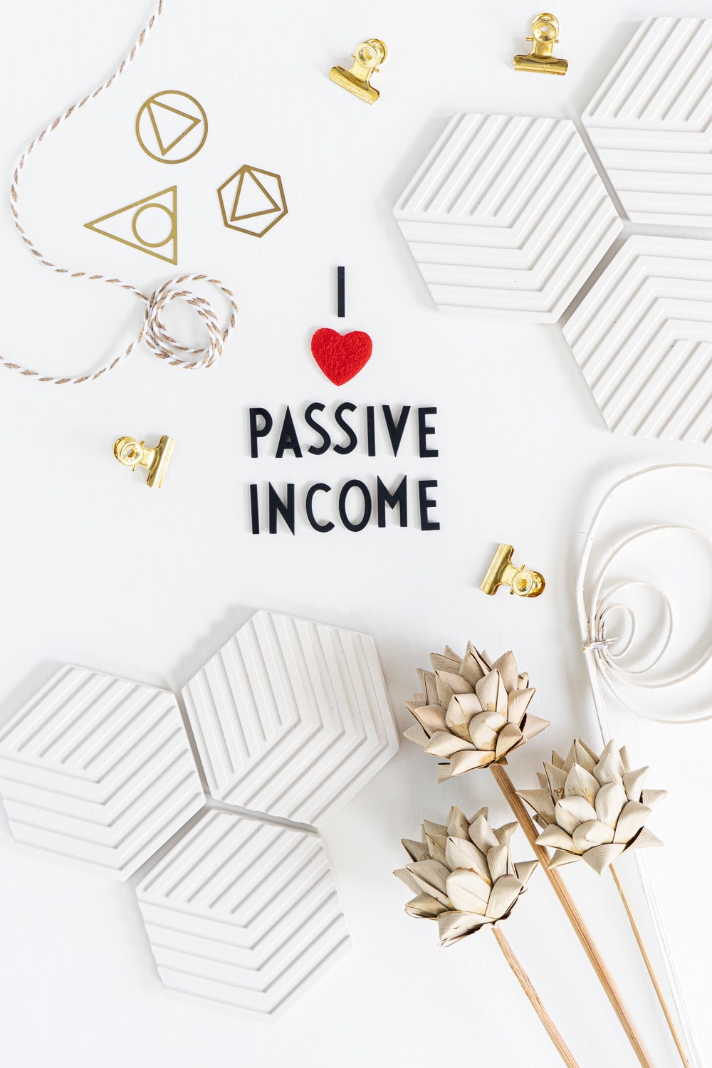 """Learn everything about the best passive income ideas in 2020! An image that shows a flat lay with black letters saying """"I LOVE PASSIVE INCOME"""""""