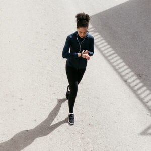 Woman walking, using an app to get paid to walk