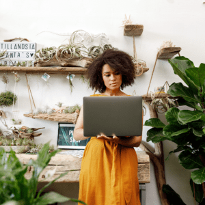 Black woman in a flower shop working on How to start an online business