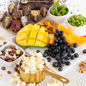 display of lots of healthy snack ideas options like fruit and popcorns