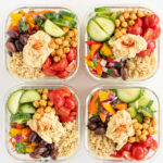 Top view of 4 Mediterranean lunch boxes in glass containers