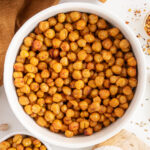 Top view of white bowls full of roasted chickpeas