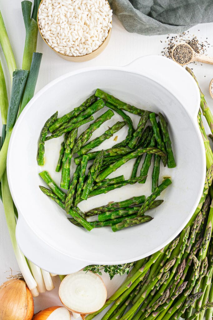 Close up of pot with asparagus tips cooking